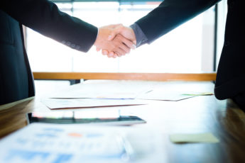 Business partnership meeting concept. Image businessmans handshake. Successful businessmen handshaking after good deal.